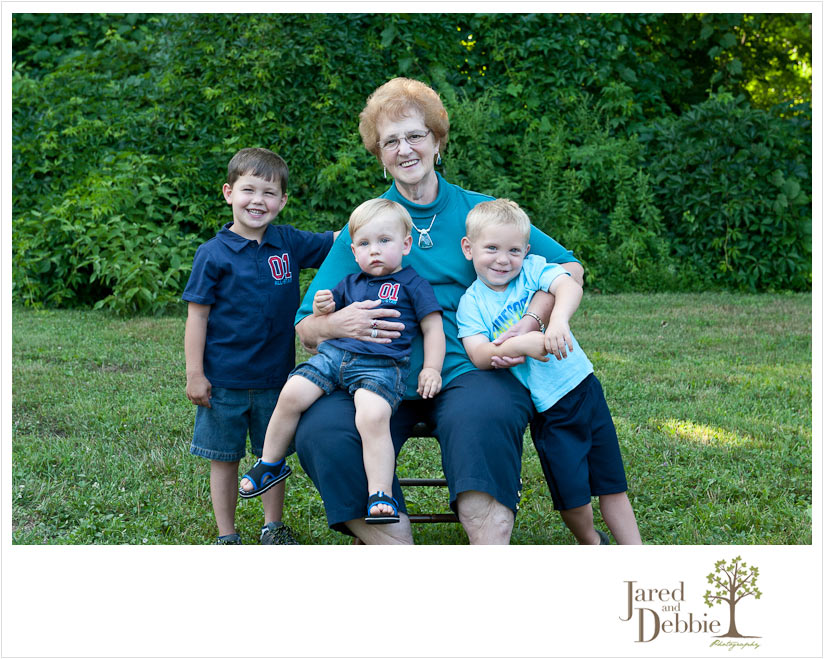 Great Grandmother with three grandsons at an extended family session with Jared and Debbie Photography