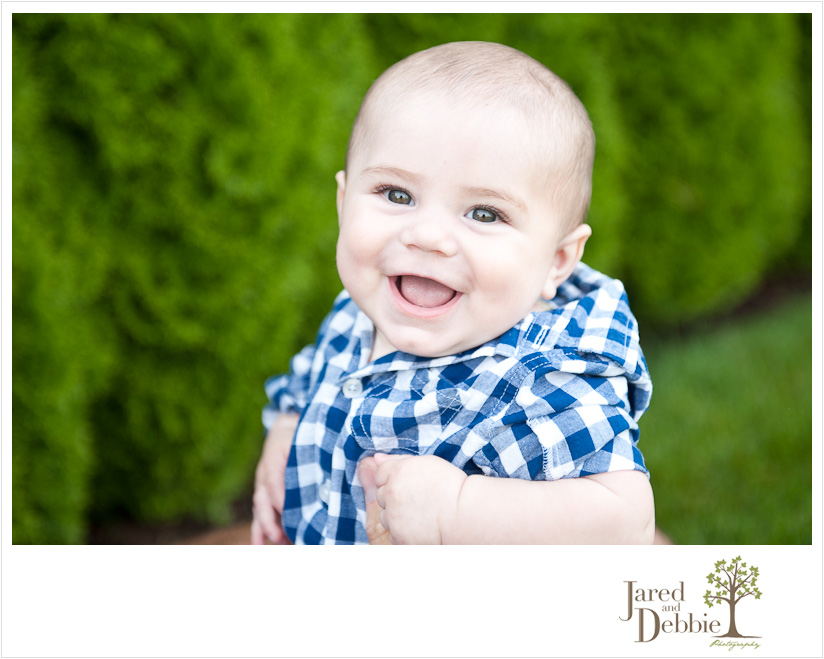 Smiling baby boy at family portrait session in Plattsburgh NY with Jared and Debbie Photography