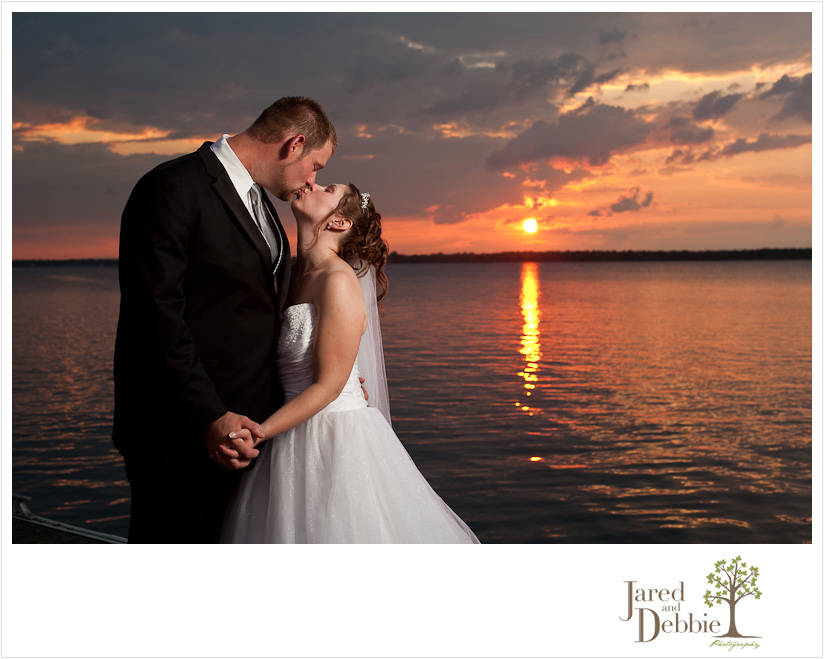 Bride and Groom at sunset at Massena Country Club wedding by Jared and Debbie Photography