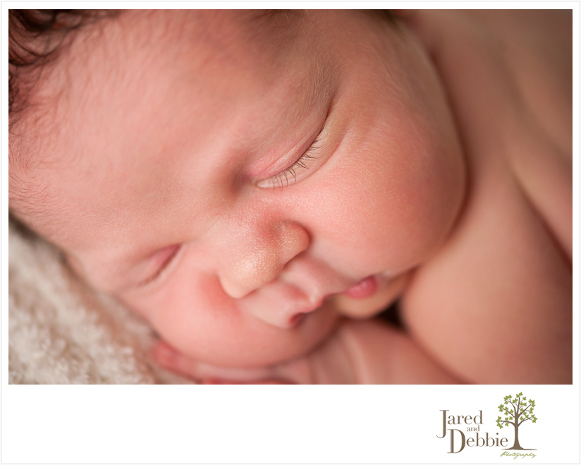 Newborn baby boy during photos with Jared and Debbie Photography