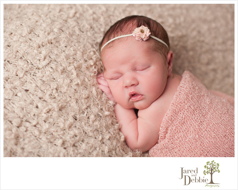 Newborn baby girl during session with Jared and Debbie Photography in Plattsburgh NY