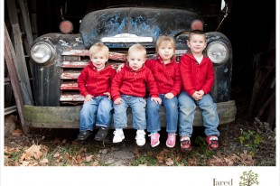Grand children in family portrait with old rusty truck