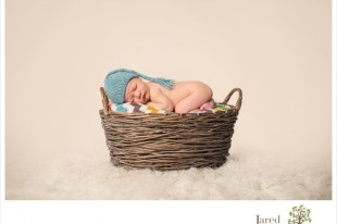 Baby boy in newborn session with Jared and Debbie Photography