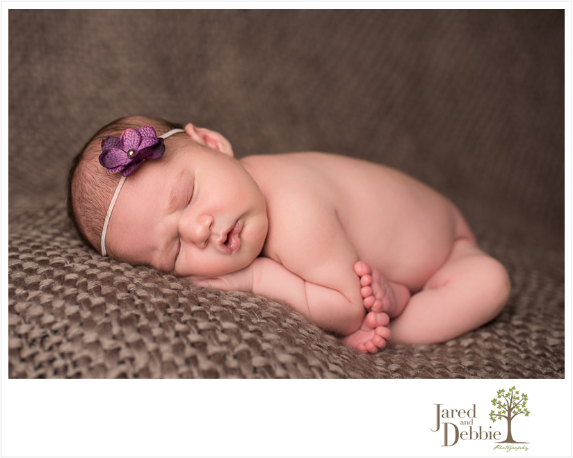 Baby girl in newborn session with Jared and Debbie Photography