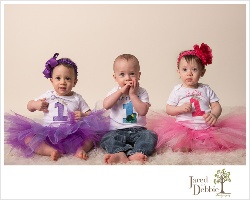 Two girls and a boy cake smash session purple blue pink