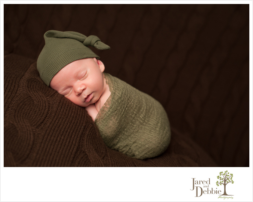 Newborn baby boy photographed by Jared and Debbie Photography