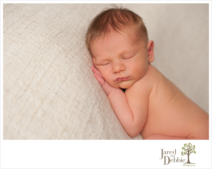 Newborn baby boy during photography session with Jared and Debbie