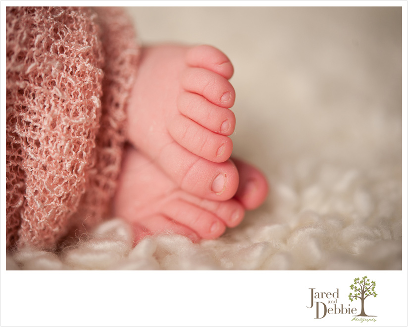 Newborn baby toes during photography session with Jared and Debbie