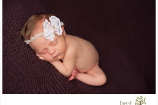 tiny baby girl on purple during newborn session with Jared and Debbie