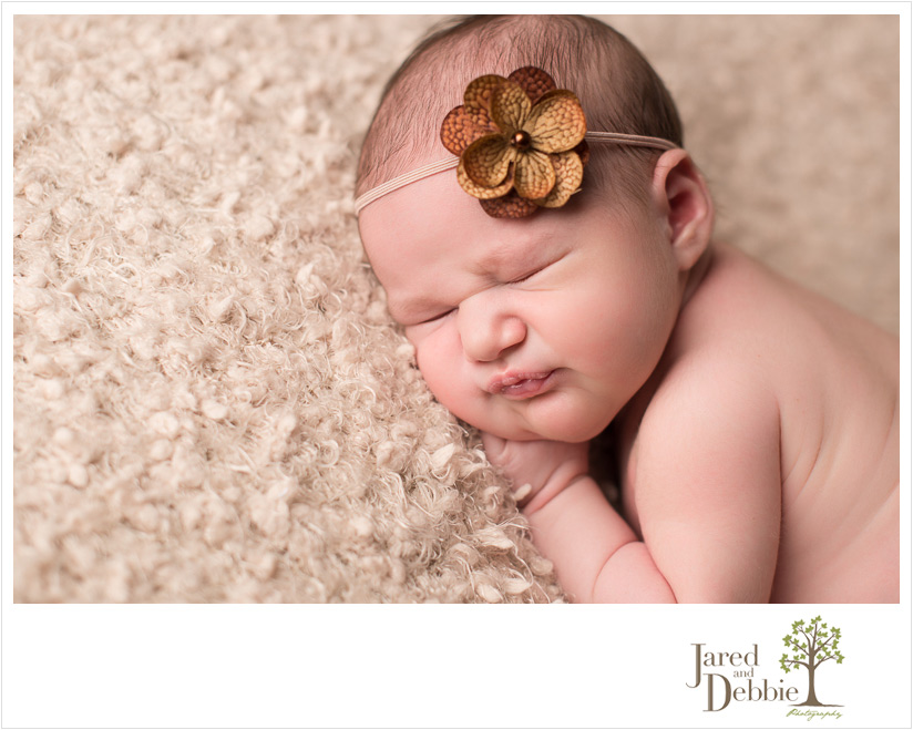 Newborn baby girl during photo shoot with Jared and Debbie