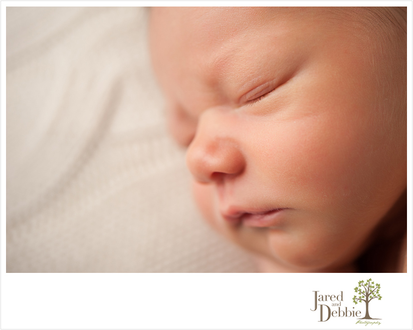 Baby boy during newborn session with Jared and Debbie Photography