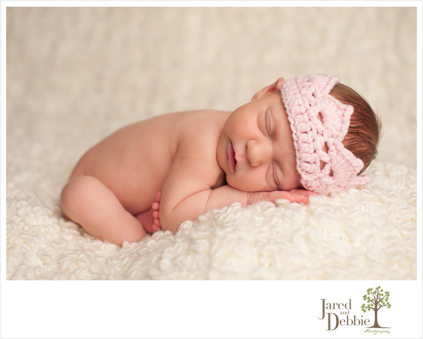 Baby girl during newborn session with Jared and Debbie Photography