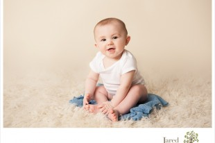 six month old baby sitting up during session with Jared and Debbie