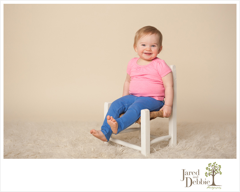 one-year-old girl during session with Jared and Debbie Photography