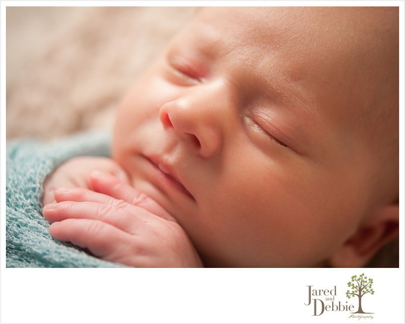 3 week old baby boy during newborn session with Jared and Debbie