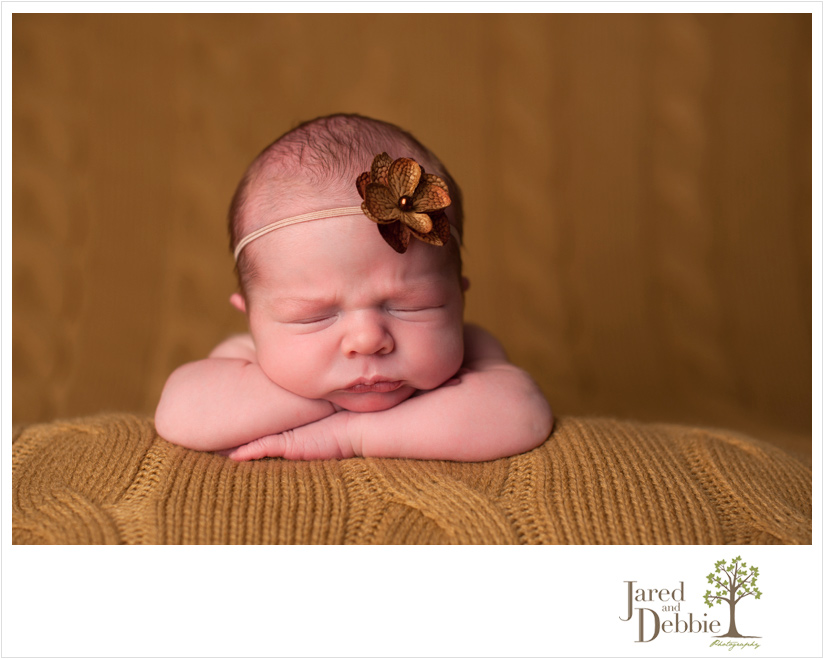baby girl during photo session with Jared and Debbie Photography