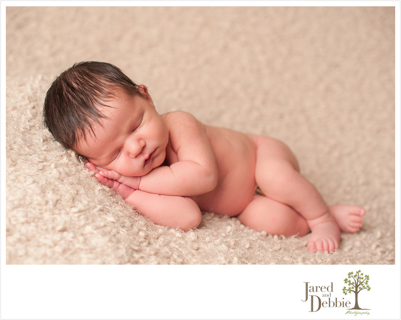 Newborn baby boy during session with Jared and Debbie Photography