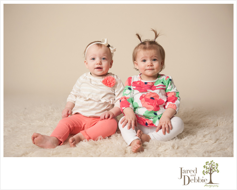 Twin girls during first birthday session with Jared and Debbie