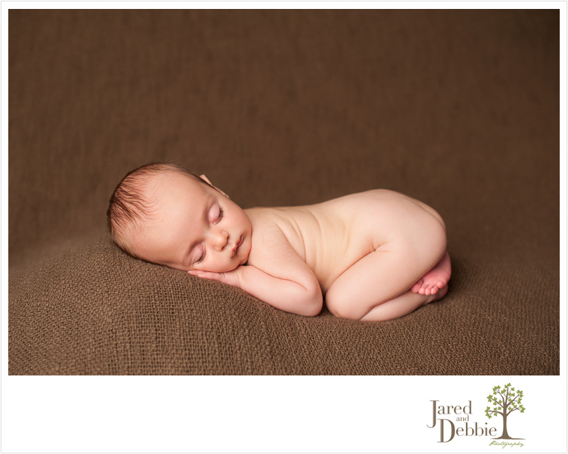 Long lashes on newborn baby boy during session with Jared and Debbie