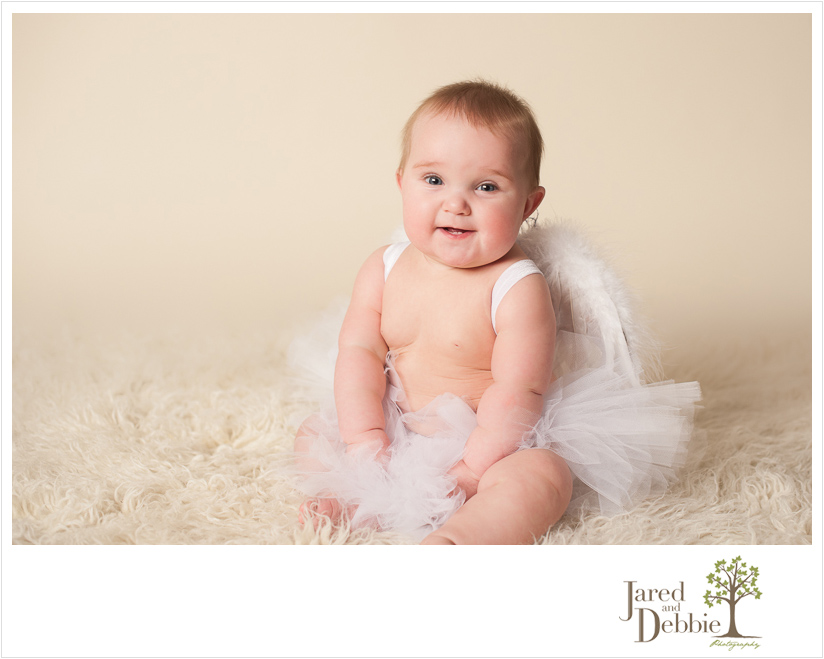 Baby girl in angel costume during session with Jared and Debbie
