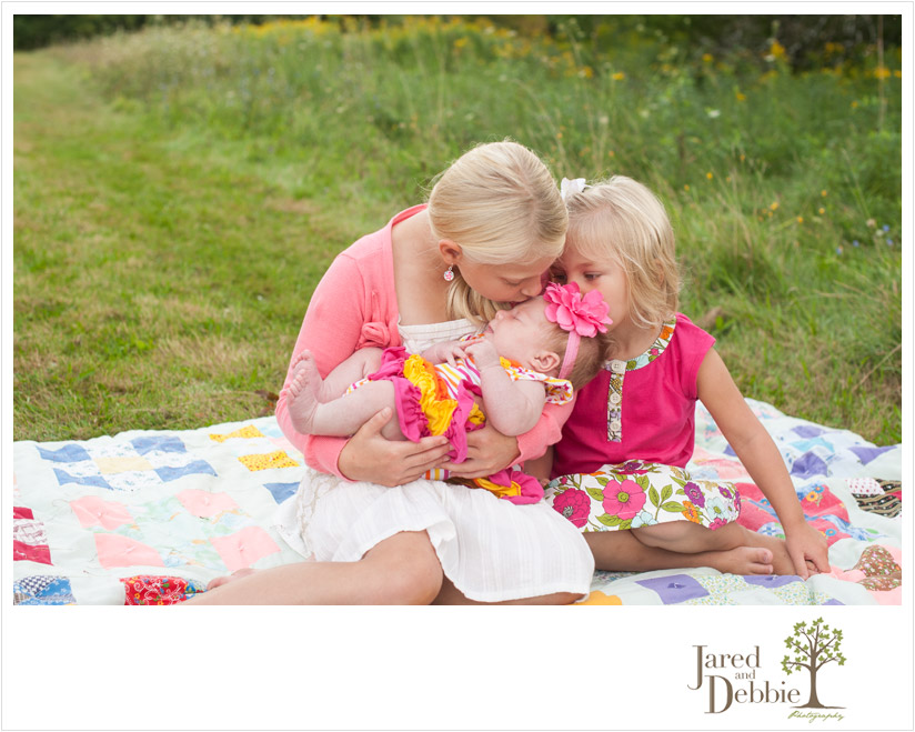 Three sisters during family photos with Jared and Debbie Photography