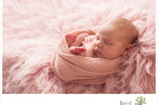 Baby girl in pink during newborn session with Jared and Debbie