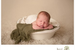 Baby Boy in bucket during newborn session with Jared and Debbie