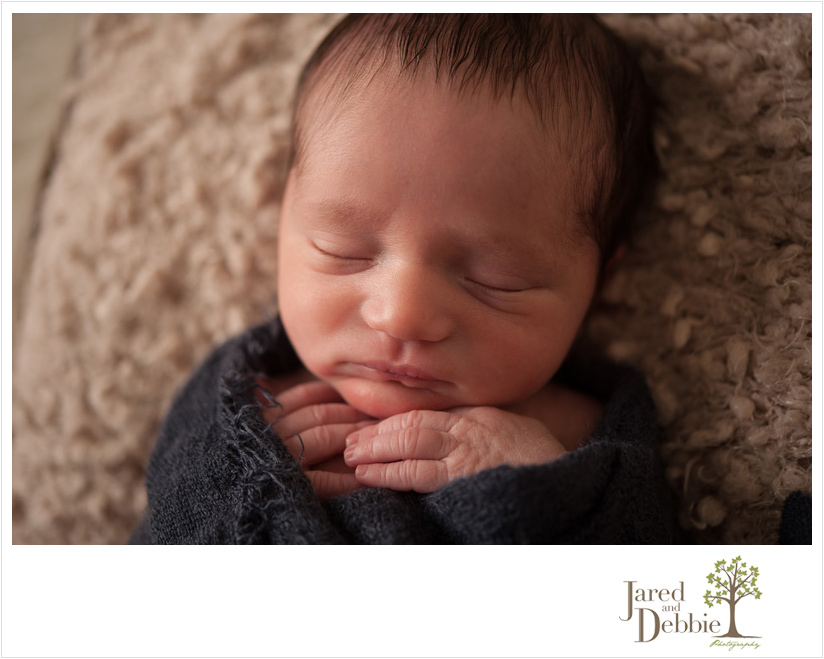Newborn Baby Boy in navy blue and green