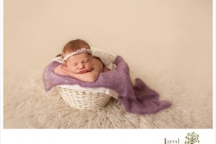 Baby girl in purple during newborn session with Jared and Debbie Photography