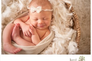 Smiling newborn baby girl