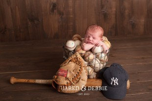 Newborn Baby in Baseballs