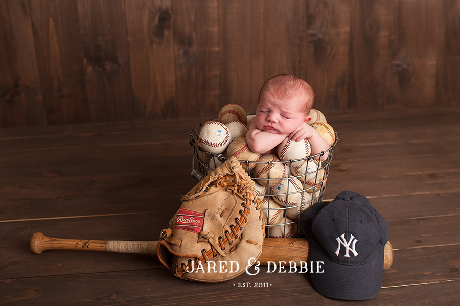 Newborn Baby in Baseballs, NY Yankees Themed newborn session